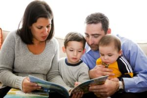 parents reading to small children